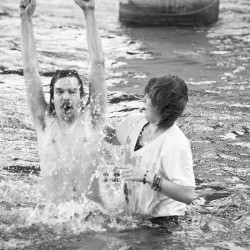 Michael gets baptized by his sister, Meghan, at UT