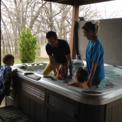 Jen and I baptizing Ethan and Olivia