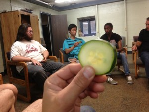 Students gather as a simple church in a dorm at Cornell. Here, they celebrate communion during worship with a cucumber. That's another story (but a good one).