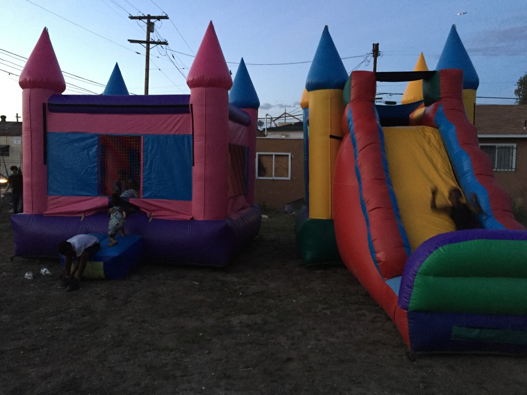 "We rented ""bouncy houses"" for kids in the neighborhood. We invited all the people we'd met so far. People had so much fun."