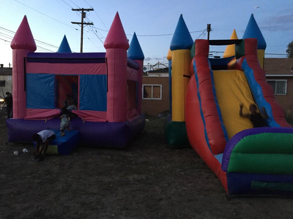 "We rented ""bouncy houses"" for kids in the neighborhood. We invited all the people we'd met so far. People had so much fun."